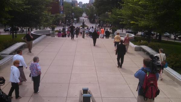 (Photo Greg Neumann/WKOW) People leave the capitol building in Madison after a bomb threat was called in.