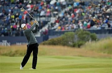 United States' Jordan Spieth plays from the second fairway during the third round at the British Open Golf Championship at the Old Course, St. Andrews, Scotland, Sunday, July 19, 2015.