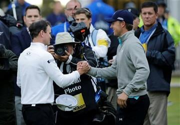 (AP Photo/David J. Phillip). United States' Zach Johnson, left, is congratulated by United States' Jordan Spieth after winning a playoff after the final round of the British Open Golf Championship at the Old Course, St. Andrews, Scotland, Monday.