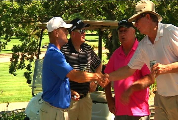Pete Kohnert, left, is congratulated Saturday after winning the 2015 Seniors County Amateur Golf Championship at Forest Hills Golf Course. He shot an even-par 68.