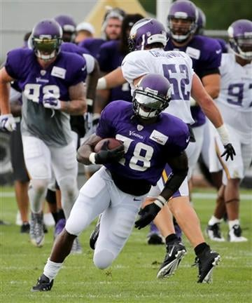 (AP Photo/Charles Rex Arbogast). Minnesota Vikings running back Adrian Peterson (28) carries the ball during the first practice in full pads at an NFL football training camp on the campus of Minnesota State University Tuesday, July 28, 2015, in Mankato.