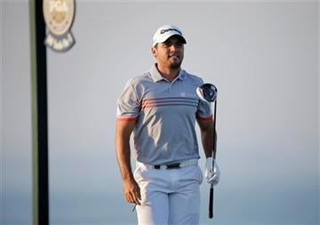 Jason Day, of Australia, watches his shot on the 16th hole during the third round of the PGA Championship golf tournament Saturday, Aug. 15, 2015, at Whistling Straits in Haven, Wis.
