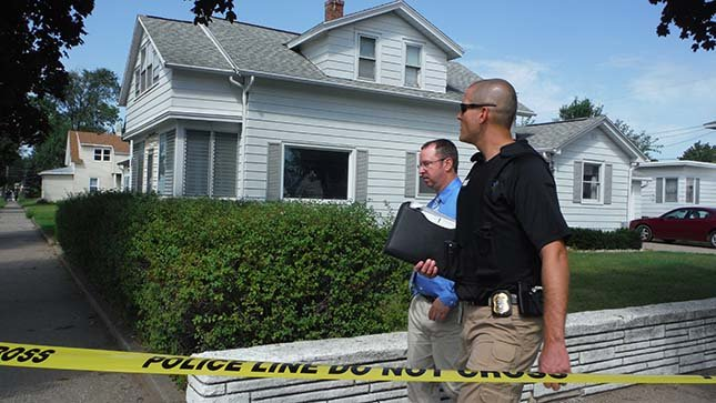 District Attorney Tim Gruenke at the scene of Friday's shooting near Green Bay and Redfield streets.