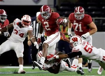 Alabama running back Derrick Henry (2) carries against Wisconsin defenders T.J. Edwards (53) and Leon Jacobs, bottom, during the first half of an NCAA college football game Saturday, Sept. 5, 2015, in Arlington, Texas.