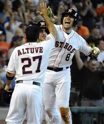Houston Astros' Jed Lowrie (8) celebrates his grand slam with teammate Jose Altuve (27) in the seventh inning of a baseball game against the Minnesota Twins, Sunday, Sept. 6, 2015, in Houston.