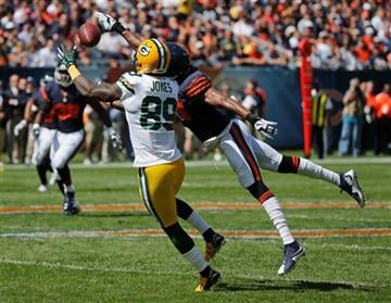 Green Bay Packers receiver James Jones (89) catches a pass under pressure from Chicago Bears defensive back Alan Ball during the first half an NFL football game, Sunday, Sept. 13, 2015, in Chicago.