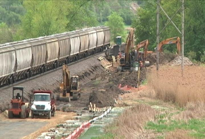 Crews construct a second line through the La Crosse River Marsh