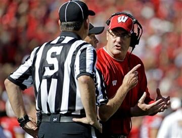 Wisconsin head coach Paul Chryst, right, argues a call during the first half of an NCAA college football game against Troy Saturday, Sept. 19, 2015, in Madison, Wis.