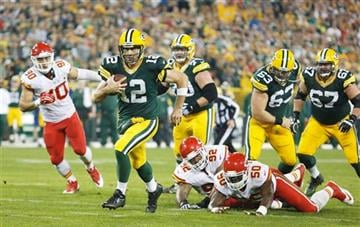 Green Bay Packers' Aaron Rodgers runs during the first half of an NFL football game against the Kansas City Chiefs Monday, Sept. 28, 2015, in Green Bay, Wis.