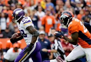 Minnesota Vikings running back Adrian Peterson scores ahead of Denver Broncos free safety Darian Stewart during the second half of an NFL football game Sunday, Oct. 4, 2015, in Denver.