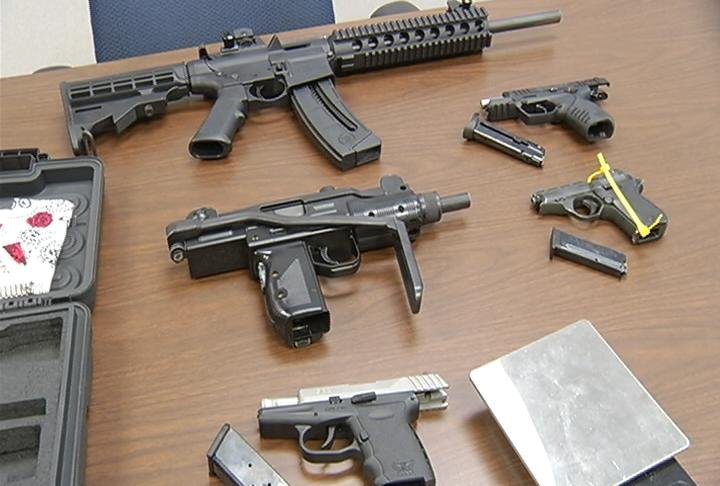 Guns seized by authorities during the arrest of John P. Vang