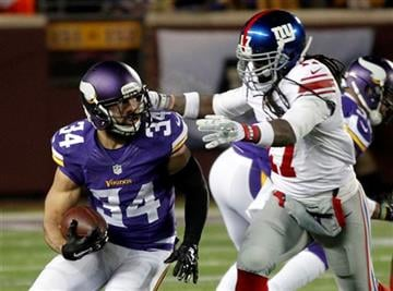 Minnesota Vikings strong safety Andrew Sendejo (34) is tackled by New York Giants wide receiver Dwayne Harris (17) after Sendejo intercepted a pass during the first half of an NFL football game Sunday, Dec. 27, 2015, in Minneapolis.