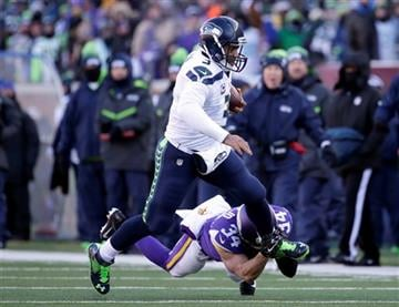 Seattle Seahawks quarterback Russell Wilson (3) runs the ball against Minnesota Vikings strong safety Andrew Sendejo (34) during the first half of an NFL wild-card football game, Sunday, Jan. 10, 2016, in Minneapolis.