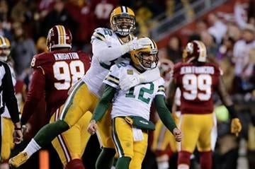 Green Bay Packers tight end Richard Rodgers (82) celebrates with quarterback Aaron Rodgers (12) after wide receiver Davante Adams caught a touchdown pass during the first half of an NFL wild-card playoff football game against the Washington Redskins.