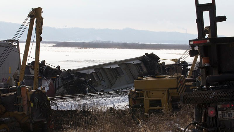 Crews work to clear up derailed train cars near the Brownsville Overlook area on Wednesday, January 27.