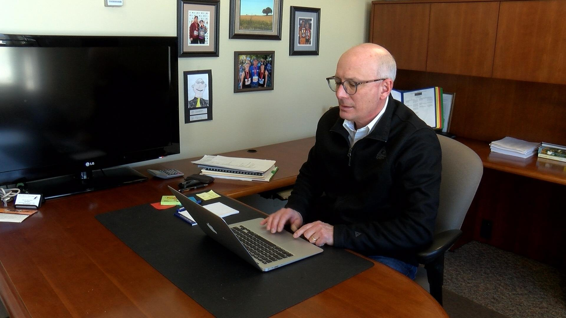 Superintendent Troy Gunderson works on a computer.