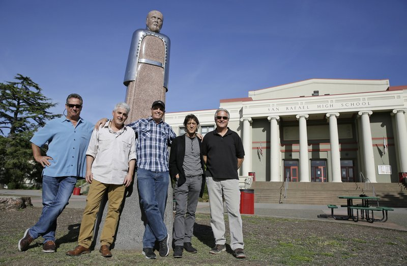 In this Friday, April 13, 2018, photo, the Waldos, from left, Mark Gravitch, Larry Schwartz, Dave Reddix, Steve Capper and Jeffrey Noel pose below a statue of Louis Pasteur at San Rafael High School in San Rafael, Calif. Friday is April 20, or 4/20.