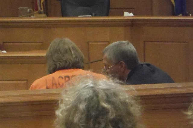 Beitlich confers with his attorney during his first court appearance Tuesday.