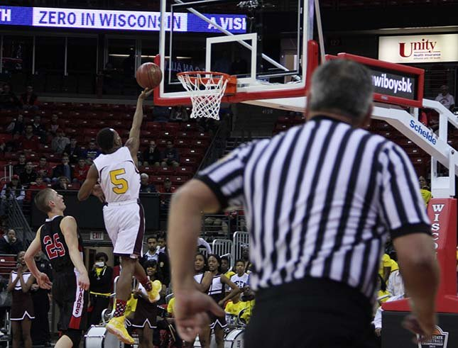 Tiwon Jones of Young Coggs goes in for two of his 29 points against Washburn Thursday  at the Kohl Center