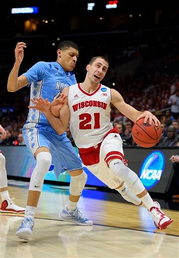 (AP Photo/Mark J. Terrill). Wisconsin guard Josh Gasser, right, dribbles past North Carolina's Justin Jackson during the first half of a college basketball regional semifinal in the NCAA Tournament, Thursday, March 26, 2015, in Los Angeles.