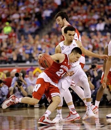 (AP Photo/David J. Phillip). Wisconsin's Bronson Koenig drives against Duke's Tyus Jones during the second half of the NCAA Final Four college basketball tournament championship game Monday, April 6, 2015, in Indianapolis.
